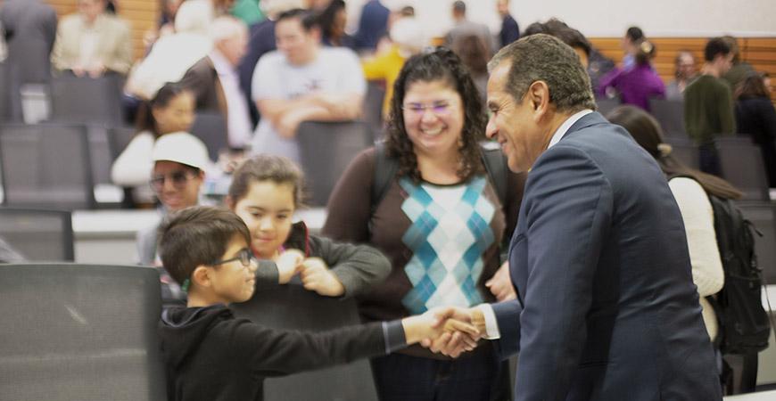 Former L.A. Mayor Antonio Villaraigosa meets with community members following Tuesday's event.